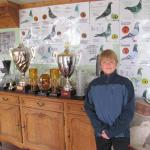 My son Kendall standing in front of some of the plaques and trophies at Franz Van Wildermeersch and Frieda Vynke lofts in Belgium